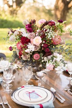 Rose, protea, and berry centerpiece | Christa Elyce Photography | see more on: http://burnettsboards.com/2014/09/americana-wedding-antlers/