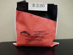Stop by our Information Desk and pick up this $2 MGC bag.  It has a front pocket - great for storing smaller research items! #genealogy #mymgc #mymgcsales