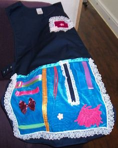 Activity Apron for people living with Dementia. Looks similar to the fidget blanket.