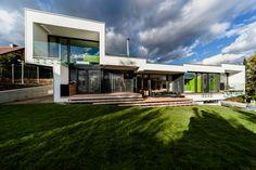 sloped semi-cantilever house by grido architektura