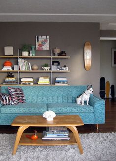 Love the blue couch color with the gray walls...