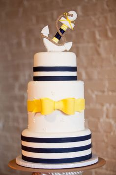 Nautical Wedding Cake with Stripes and a Yellow Bow, Topped with an Anchor