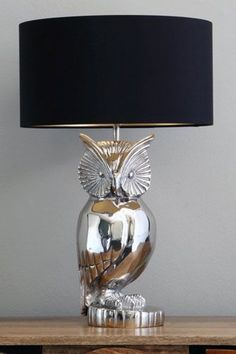 We love this owl lamp. It's perfect for any living room big or small. #ppmapartments  #chicagoapartments #apartnetsinchciago #chicagorentals