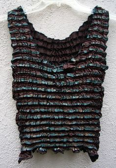 Also on my list to try. Shibori permanent pleating. I certainly have plenty of polyester in my fabric stash. tank top, shibori tank