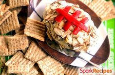 Cheddar-bacon-ranch #cheese ball that looks like a #football! Perfect for #tailgating! | via @SparkPeople #recipe #fall #snack