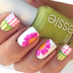 How pretty and unique! I love the stripes, polka dots and flowers. What a beautiful mix of patterns and shades. Love it! Do you? #nailart #naildesign