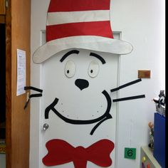 The cat in the hat door. Could do this as a Grinch with green plastic table cloth covering the door and a Santa hat made out of red and white paper.