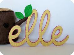 Cool layered cardboard letter decor made with food boxes. So pretty.