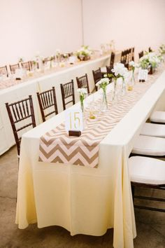 #tablescapes #chevron | Photography by kaylaadams.net | Floral Design by maranathaflowers.com |   Read more - http://www.stylemepretty.com/2013/08/01/riverside-wedding-from-kayla-adams/ sweetheart table, bud vases, kayla adam, weddings, floral designs, table runners, long tables, table numbers, flower photography