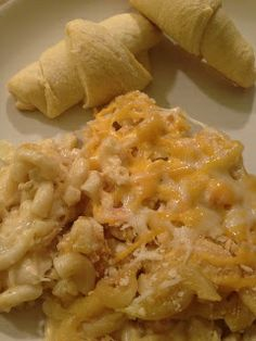 Ingredients:    1 onion, chopped  3 tbsp butter or margarine  2 (10 3/4 oz) can cream of chicken soup  2 cups shredded cheddar cheese  1 cup milk  3 1/2 cups cooked chicken, shredded or cubed  2 1/2 cups cooked macaroni pasta  Salt/Pepper  1/4 cup crushed Ritz crackers