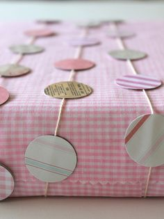 Paper garlands to make and use on wrapped gifts! Great way to coordinate gifts with party decorations! | Homework