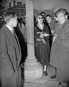 Original caption: 11/18/1933-Washington, D.C.: Sarah Roth, who took part in the anti-Hitler demonstration held in front of the German Embassy in Washington, D.C., Nov. 18, took this means of defying police. Her comrades chained her to a lamp-post so effectively that it took police almost half an hour to release her with the aid of a hacksaw, hammer and chisel. In the meantime, Sarah kept up a continuous harangue with police powerless to stop her. Fifteen Communists were arrested.