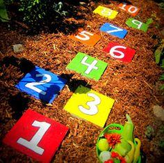 Hopscotch stepping stones as DIY garden art!  My grandboys will love this idea for our garden..