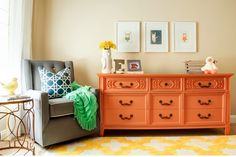 How to do a modern vintage nursery: pair a vintage painted dresser with a great modern glider.