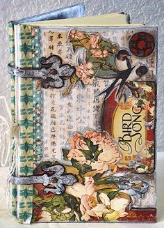 Beautiful altered Bird Song book by @Theresa Burger Pearson shared on our Ning site! #graphic45 #ning #alteredart