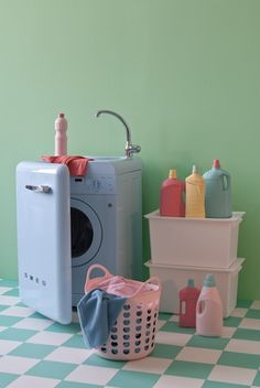 smeg washing machine ~ and I love the idea of spray painting bottles of laundry soap and such!