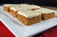 Gingerbread Bars with Orange Cream Cheese Frosting - This recipe makes a lot. Perfect for taking to a holiday gathering!