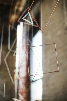 hanging metal geometric shapes, photo by Alexandra Whitney, styling by Juniper & Dash http://ruffledblog.com/mixed-metal-geometric-inspiration #geometric #weddingideas #backdrops