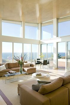 Designed by ZeroEnergy Design this modern green home featuring a spectacular water and sunset view is located in Truro, Massachusetts.