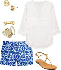 printed shorts white tunic, gold accessories