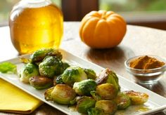 Apple Cider Brussels Sprouts - Crispy roasted Brussels sprouts finished with a sweet apple cider reduction and pinch of cinnamon. Dessert or vegetable? It's hard to tell!
