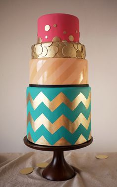 Pink and teal cake with gold chevron accents