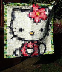 Pixelated Hello Kitty. Don't usually like those pixel quilts, but this one is cute.