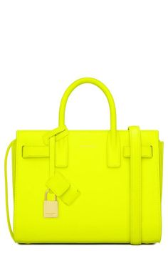 Yellow arm candy. Tote by Saint Laurent