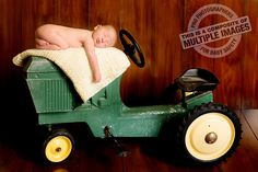 Newborn Baby Boy Pose on Antique John Deere Tractor- THIS IS A COMPOSITE IMAGE Click to see more of this beautiful session. ©www.kensiem.com