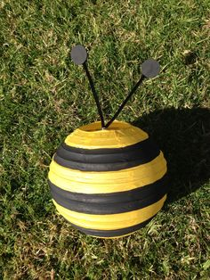 DIY perhaps? Add black electrical tape to a yellow paper lantern. Shop lanterns online at http://www.partylights.com/Lanterns/Lanterns-by-Color.