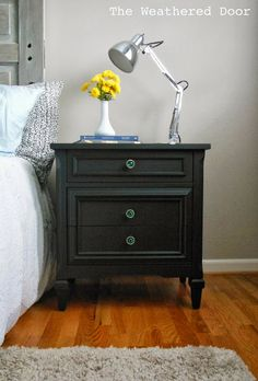 The Weathered Door: A pair of black nightstands with emerald knobs