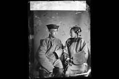 In this image of a married couple from Xiamen, a port city in south-eastern China, the husband is looking away because at the time it was thought improper for a couple to face each other.