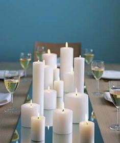 light up your table by placing pillar candles on a mirror as the centerpiece.