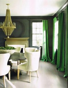 The green drapes bring a wonderful burst of color to this room.