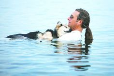 Nineteen year old Schoep is peacefully sleeping under his owner John Unger's chin, as they float  in the warm waters of Lake Superior.   Schoep has lived with John since he was 8 months old and now has arthritis, but here he can escape the pain, relax and sleep - and his expression is one of pure bliss................courtesy Life With Dogs website.