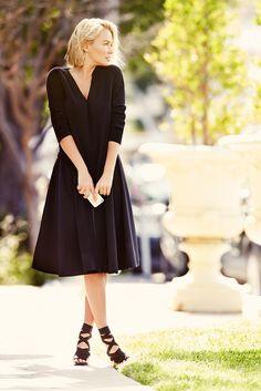 Black midi skirt and a black v-neck cardigan on Lara Bingle