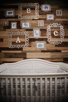 Wood pallet accent wall in nursery