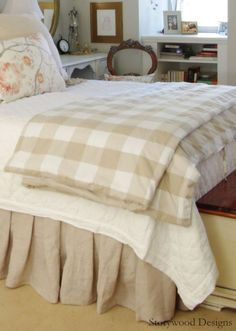 DIY Linen Bedskirt, DIY Upholstered Headboard and Ikea's Buffalo Check Duvet Cover (Emmie Ruta) in the master bedroom makeover