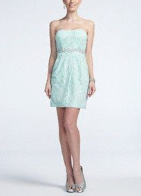 You will own the spot in this ultra-feminine lace dress!  Strapless lacebodicefeatures scintillating waist trim.  Short and chic skirt has box pleats at thefrontand featuresside pockets.  Fully lined. Back zip. Imported polyester/nylon/spandex blend.  Hand wash gently inside out in cold water. Do not wring or twist, do not bleach, dry flat. Do not iron glitter. Do not dry clean.Also available in Plus sizes as Style 3231BZ3XW.