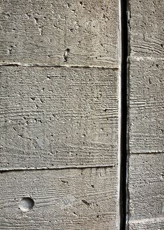 manmade material (concrete) with elements of nature (wood grain)