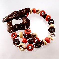 Coconut shell clasp with glass loop beads all made by Tracy Bell