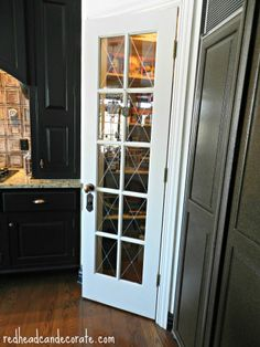 "Look closely and you can see how I made our pantry door stand out.  The ""X"" in the windows are actually stickers from Michael's!  More tips about the antique hardware and kitchen found on my blog! ~ Julie redheadcandecorate.com"