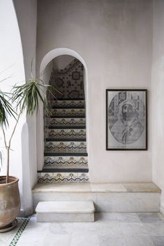 Little arched way in a Moroccan riad with cute tiling. #Moroccan #Archedway.