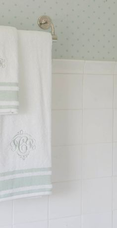 petite polka dotted wallpaper and monogrammed towels