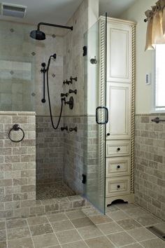 Tile, built in storage cabinet.