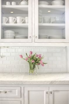 Allison Harper Interior Design: Stunning all white kitchen with beveled subway tile backsplash. White Shaker style ...