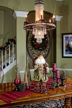 Christmas- Dining Room Table Display. Loving the chandelier with the berry accents