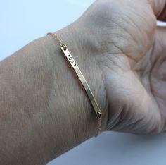 Personalized skinny gold nameplate bracelet -  Long bar bracelet  with tiny font - Slim 14k gold fill ID bracelet - Trendy fashion jewelry. $47.00, via Etsy.