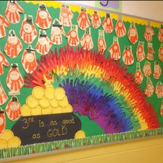 """"""" ____ Grade is as Good as GOLD!"""" is a fun title for a March bulletin board display.  I love the colorful rainbow that was made out of hands.  The leprechauns were made using students' hand prints."""