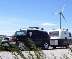 The Black FJ and Boler duo.. wind and solar powered.. ;-)